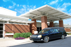Funeral Home. A hearse outside a funeral home on a bright sunny day Royalty Free Stock Images