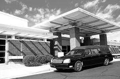 Funeral Home. A hearse outside a funeral home on a bright sunny day Royalty Free Stock Photo