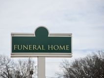 Funeral Home and Memorial Gardens. A funeral home is where decease people who have died are prepared for burial by embalming or cremation, some funeral homes stock photos