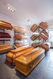 Funeral home. Wooden brown coffins in a funeral home Stock Image