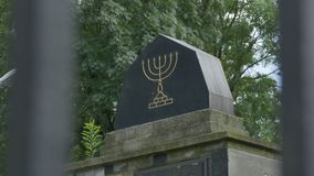 Funeral Monument Jewish Menorah. A funeral jewish monumnet with the menorah sculpted on it stock video footage