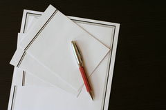 Funeral notice (card) and envelopes on the black table Royalty Free Stock Image