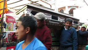 Funeral Procession, Death, Guatemala People. A funeral procession carries the casket of a family member as they walk to the cemetery to bury the body. The people