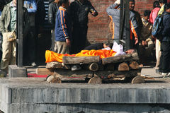 Funeral pyre. A dead woman is on the funeral pyre ready to be cremated at pashupatinath near kathmandu in nepal.december 2010 stock photo