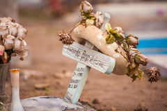 Funeral wreath. Made of dried or silk roses and a styrofoam ring on a small wooden cross Stock Images
