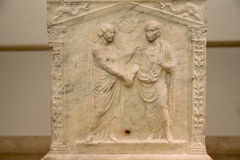A funerary slab of a married couple is seen in the baths of Diocletian in Rome Royalty Free Stock Image
