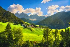 Funes Valley Santa Magdalena view and Odle mountains, Dolomites Alps, Italy. Funes Valley Santa Magdalena church view and Odle mountains, Dolomites Alps royalty free stock images
