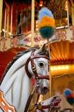 Funfair. A white horse on a colourful merry-go-round stock photos