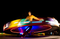 Funfair ballerina. Mechanical Ballerina in the funfair on black background during evening Royalty Free Stock Images