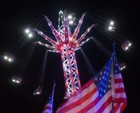 Funfair carousel stylu przejażdżka przy nocą Fotografia Stock