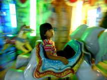 Funfair. The children were enjoying rides at a funfair in the city of Solo, Central Java, Indonesia stock image