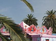 Funfair detail and palms Royalty Free Stock Photo