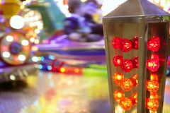 Funfair fairground attraction nigh colorful light. Funfair fairground attraction night colorful motion lights Stock Photo