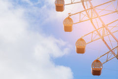 Funfair ferris park against with blue sky. Background Royalty Free Stock Images