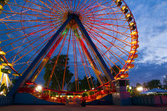 Funfair ferris wheel. Big funfair ferris wheel at dusk royalty free stock photography