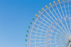 Funfair festival ferris wheel against blue sky. Background Royalty Free Stock Image