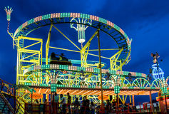 Funfair by night. Funfair Volksfest Germany in evening royalty free stock photo