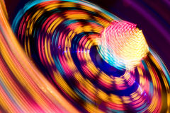 Funfair ride. Long exposure of a funfair ride at night stock photography