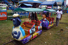Funfair rides. Workers prepare for funfair rides in the city of Solo , Central Java , Indonesia Royalty Free Stock Image