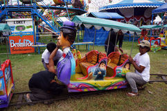 Funfair rides. Workers prepare for funfair rides in the city of Solo , Central Java , Indonesia Royalty Free Stock Photography