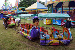 Funfair rides. Workers prepare for funfair rides in the city of Solo , Central Java , Indonesia Royalty Free Stock Photos