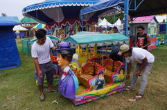 Funfair rides. Workers prepare for funfair rides in the city of Solo , Central Java , Indonesia Royalty Free Stock Photo