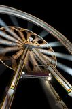Funfair with spinning ferris wheel Royalty Free Stock Images
