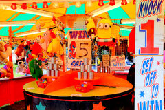 Funfair stall. Tibshelf, Derbyshire, UK. July 22, 2017. A Knock-one-set-off to win game of chance stall with prizes on display at the annual carnival at Royalty Free Stock Images