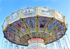 Funfair swing ride. Close up of a swing ride at a funfair Stock Photo