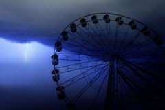 Funfair wheel in Bournemouth on a stormy day. The close up detail of a funfair wheel in Bournemouth, Devon, England Royalty Free Stock Photo