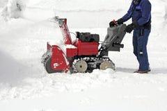 Snowborttagning royaltyfria bilder