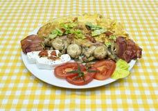 Funghi ed uova per la prima colazione Immagine Stock