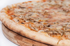 Funghi pizza on the wooden board Royalty Free Stock Photography