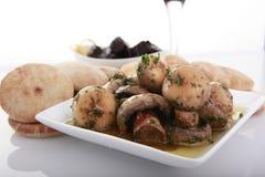 Funghi in salsa di aglio immagini stock libere da diritti
