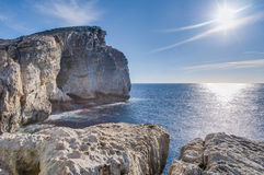 Fungus Rock, on the coast of Gozo, Malta. Fungus Rock, colloquially known as the General's Rock, is a 60 meters high  islet at the entrance to the Dwajra Bay, on Royalty Free Stock Image