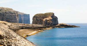Fungus Rock, Dwajra Bay, Gozo, Malta. Fungus Rock, General's Rock, entrance to the Dwajra Bay, Gozo, Malta in the sun in summer Stock Images
