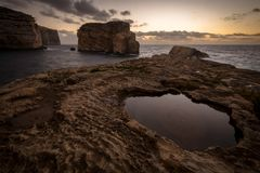 Fungus Rock in the Dwejra Bay, Malta Gozo. Sunset on Fungus Rock on Malta Gozo. Dwejra Bay at the west coast of the Maltese Island of Gozo Royalty Free Stock Photography