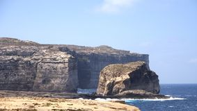 Fungus Rock, Gozo Island, Malta. Fungus Rock next to the Azure Window, Gozo Island, Malta Royalty Free Stock Image