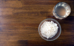 Fungus - zooglea 'Indian Maritime rice'. In a glass plate on a wooden background. Infusion of sea rice Stock Image