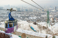 Funicular in Almaty, Kazakhstan. ALMATY, KAZAKHSTAN – MARCH 10, 2014: funicular with tourists and view of the foggy city of Almaty, Kazakhstan Royalty Free Stock Photography
