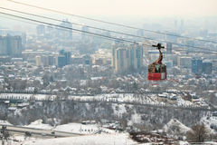 Funicular in Almaty, Kazakhstan. Almaty, KAZAKHSTAN – MARCH 10, 2014: funicular with tourists and view of the foggy city of Almaty, Kazakhstan on march 10 Royalty Free Stock Photo