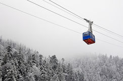 Funicular crossing over the snowy forest Stock Photography