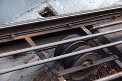 Funicular details. Rails, moving traction cable Stock Photo
