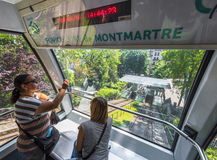 In the funicular of Montmartre. Tourists in the funicular at Montmartre. Paris, France Stock Photos