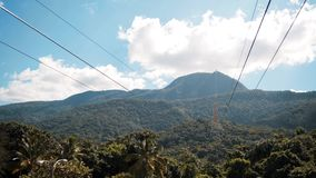 Funicular with a view of Puerto Plata Dominican Republic. 4k UHD Funicular with a view of Puerto Plata beautifull epic mountain with green trees blue sky clouds stock video footage