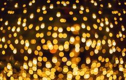 Funkeln beleuchtet Hintergrund Feiertag bokeh Beschaffenheit dunkles Gold und Schwarzes Lizenzfreies Stockfoto
