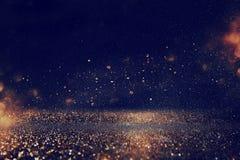 Funkeln beleuchtet Hintergrund Gold, Blau und Schwarzes lizenzfreies stockfoto