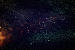 Funkeln beleuchtet Hintergrund Gold und Schwarzes stockfoto