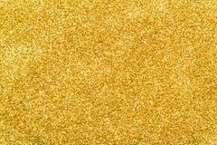 Funkelnde Paillette des Goldfunkeln-Hintergrundes Stockfotos