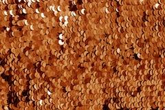 Funkelnde Paillettebeschaffenheit im orange Ton lizenzfreies stockbild
